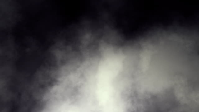 Dark swirling smoky clouds looping animation video