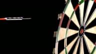 Dart hitting bull's eye, slow motion video