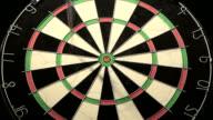 Darts hit dartboard including the bullseye video