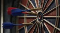 Darts striking a dartboard. Slow motion. video