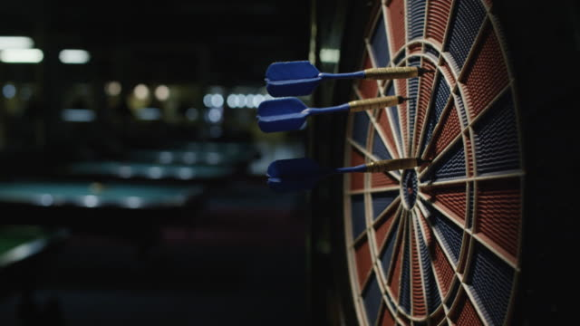 Darts striking a dartboard. Slow motion. video