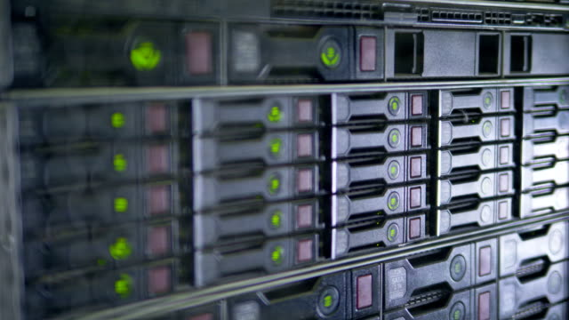 Data servers working. Flashing LED lights of network station. 4K video