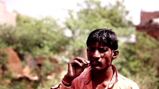 Datun or brushing teeth using plant twig video