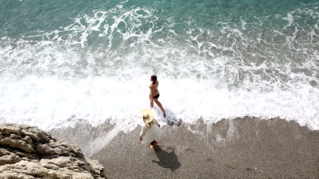 Daughter joins mother for beach walk video