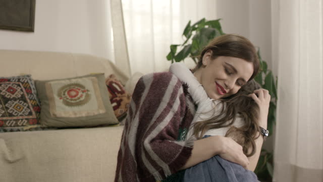 Daughter rushes into mother's arms at home and gives her a big hug. Shot on RED EPIC Cinema Camera in slow motion. video