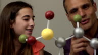 Daughter Shows Father her Science Project of a Molecule ECU video