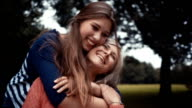 Daughter Surprises Mother With a Hug From Behind video