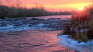 Dawn over Rushing winter river video