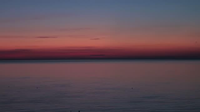 Dawn, Sunrise over the sea; time lapse skyscape video