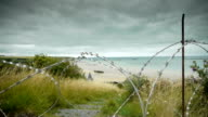 D Day coastline and barbed wire at Arromanches, France video