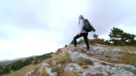 Day hiking woman on top of mountain plateau Ai-Petri crane shot video