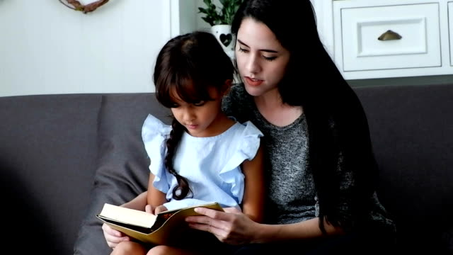 Day in the Life of a Family : Mother and daughter reading book.HD format. video