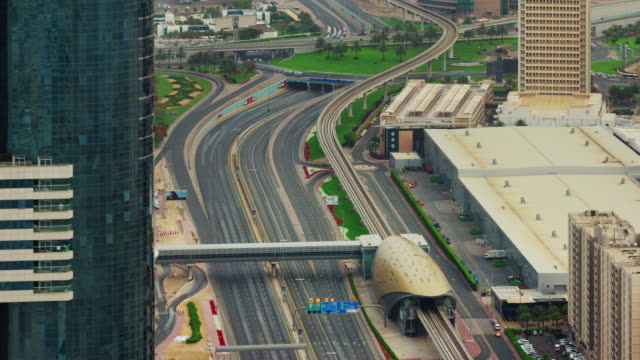 day light dubai downtown main road metro station roof view 4k time lapse united arab emirates video