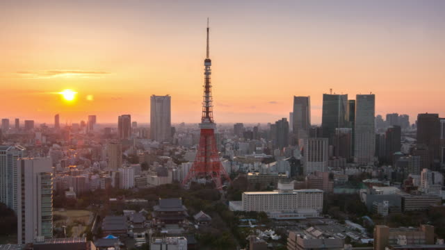 Day to night Time Lapse : Cityscape of Tokyo , Tokyo tower aerial view at sunset time video