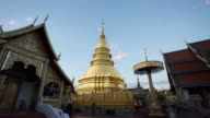 Day to night time lapse of golden pagoda video