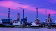 HD day to night time lapse,petrochemical oil refinery plant along a river video