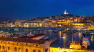 4K Day to Night Time-lapse: Marseille Vieux Port notre dame video
