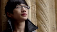 daydreaming young chinese man video