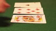 POKER: Dealer hands out cards on a green desk video