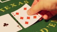 POKER: Dealer hands out cards on a green table (top view) video