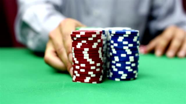 dealer moves a stack of poker chips video