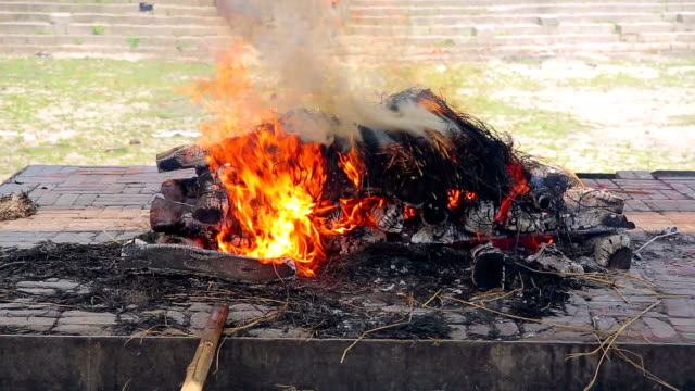 death corpse burning cremation fire, pashupatinath temple, kathmandu, nepal video