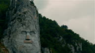 Decebalus (Decebal) king rock statue by the Danube River on a cloudy day video