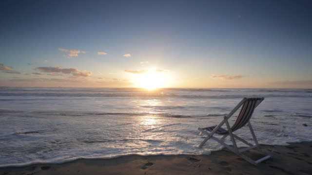 Deck Chair on the Beach at Sunset video