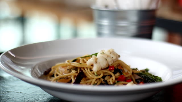 Decorate Spaghetti with basil video