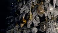 Decorated artificial fir tree covered with frost wait its time video