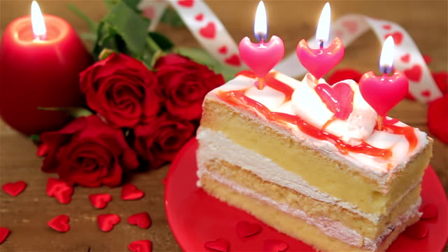 Decorated cake with candles and roses for Valentine's Day video
