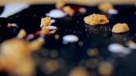 decorated chocolate Dessert with honey crumbs and cream in a restaurant video