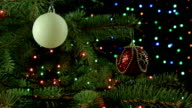 Decorated Christmas tree on blurred, sparkling and fairy background video