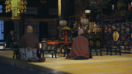 Decorated interior in the Japanese temple and three monks video