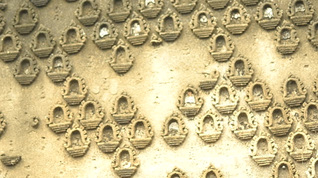 decorated stucco on the wall of ancient temple video