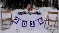 Decorated table standing in the snow. video