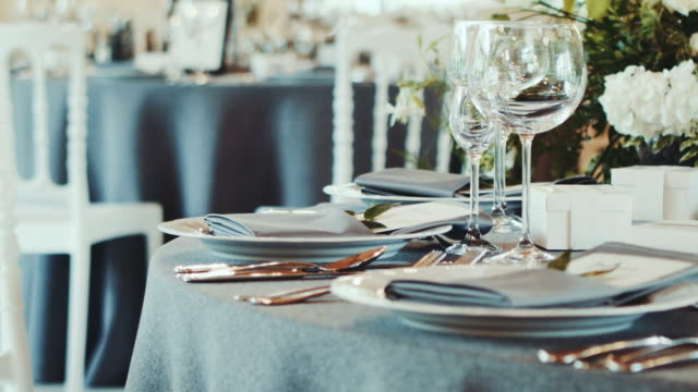 Decorated wedding table. Wedding reception venue with flowers. video