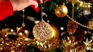 Decorating Christmas tree close-up video