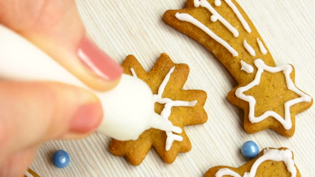 Decorating with food icing. Making Christmas Gingerbread Cookies video