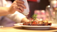 Decoration meat thyme and pepper and topping, water video