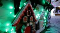 Decorative gingerbread house on a festive winter street video
