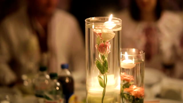 Decorative table setting pan with candle lights at a wedding reception. 1080p HD. video