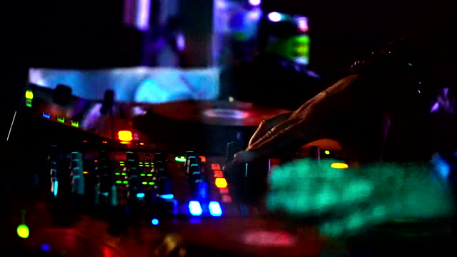 Deejay mixing  songs at a gig. video