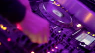 Deejay tweaking controls on sound board, party in the nightclub video