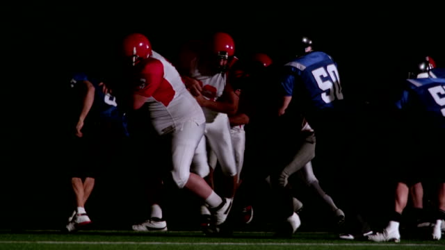 Defenders tackle the running back video
