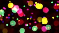 defocused christmas lights loopable background video