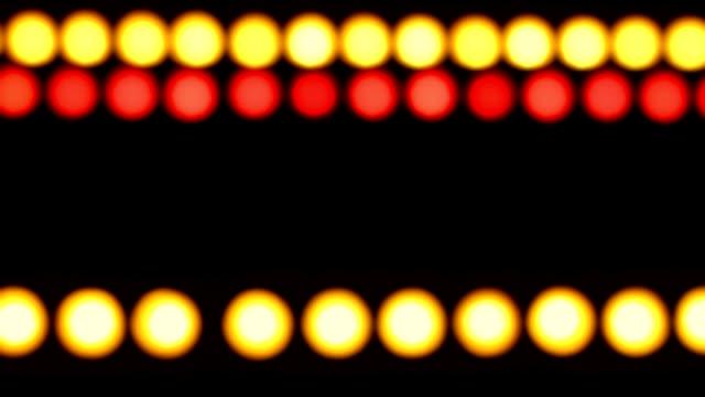 Defocused colored lights on  black background video