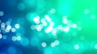 Defocused glitter on blue and green colour video