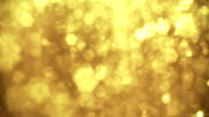 Defocused Gold Particles - loopable video