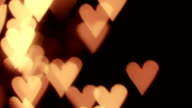 Defocused light reflections in hearts shape. Loopable background video